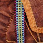 Sydsamiskt vävt band. Detalj från sydsamisk skinnryggsäck.
